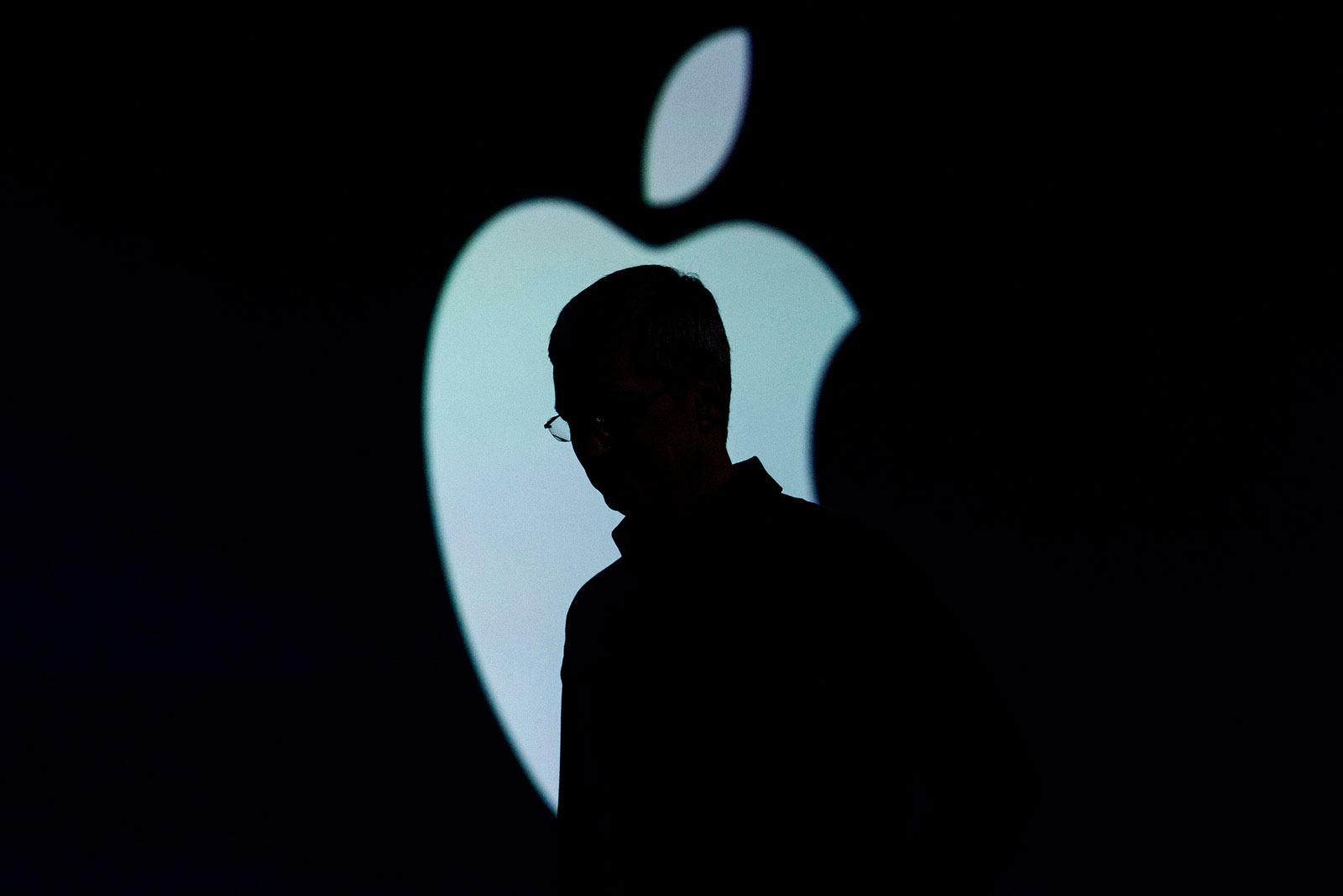 The silhouette of Tim Cook, chief executive officer of Apple