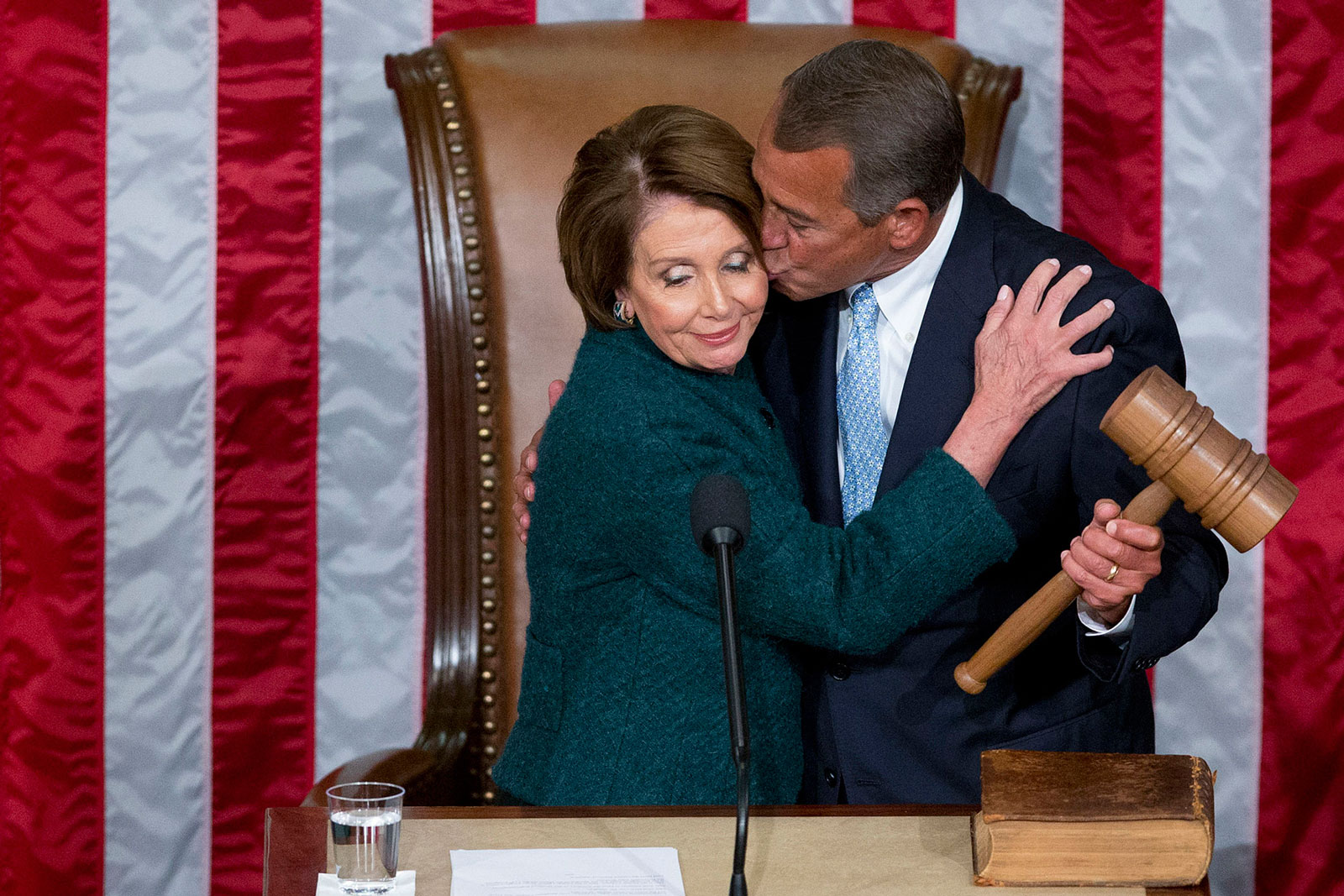 U.S. House Speaker John Boehner (R-Ohio), right, kisses U.S. House Minority Leader Nancy Pelosi (D-Calif.) after she passed him the gavel during the first session of the 114th Congress in the House Chamber at the U.S. Capitol in Washington on Tuesday, Jan. 6, 2015.