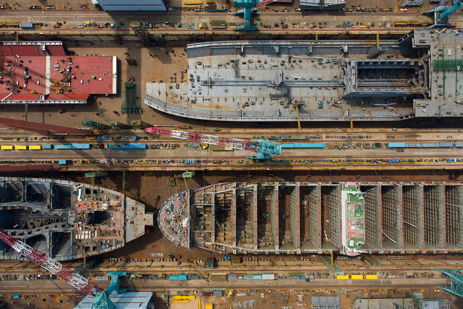 Ships stand under construction in this aerial photograph taken above the Hyundai Heavy Industries shipyard in Ulsan, South Korea