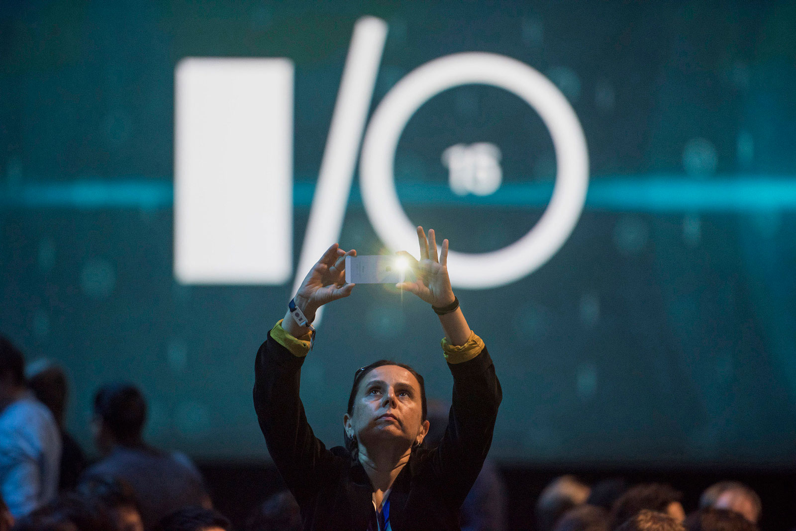 An attendee takes a photograph before the start of the Google I/O annual developers conference in San Francisco