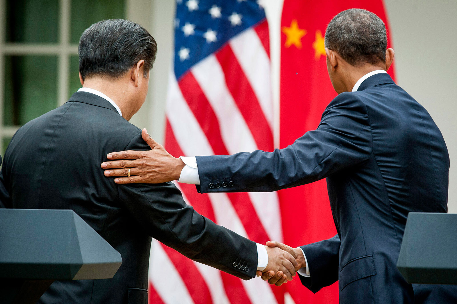 Xi Jinping, China's president shakes hands with U.S. President Barack Obama following a joint news conference in the Rose Garden at the White House