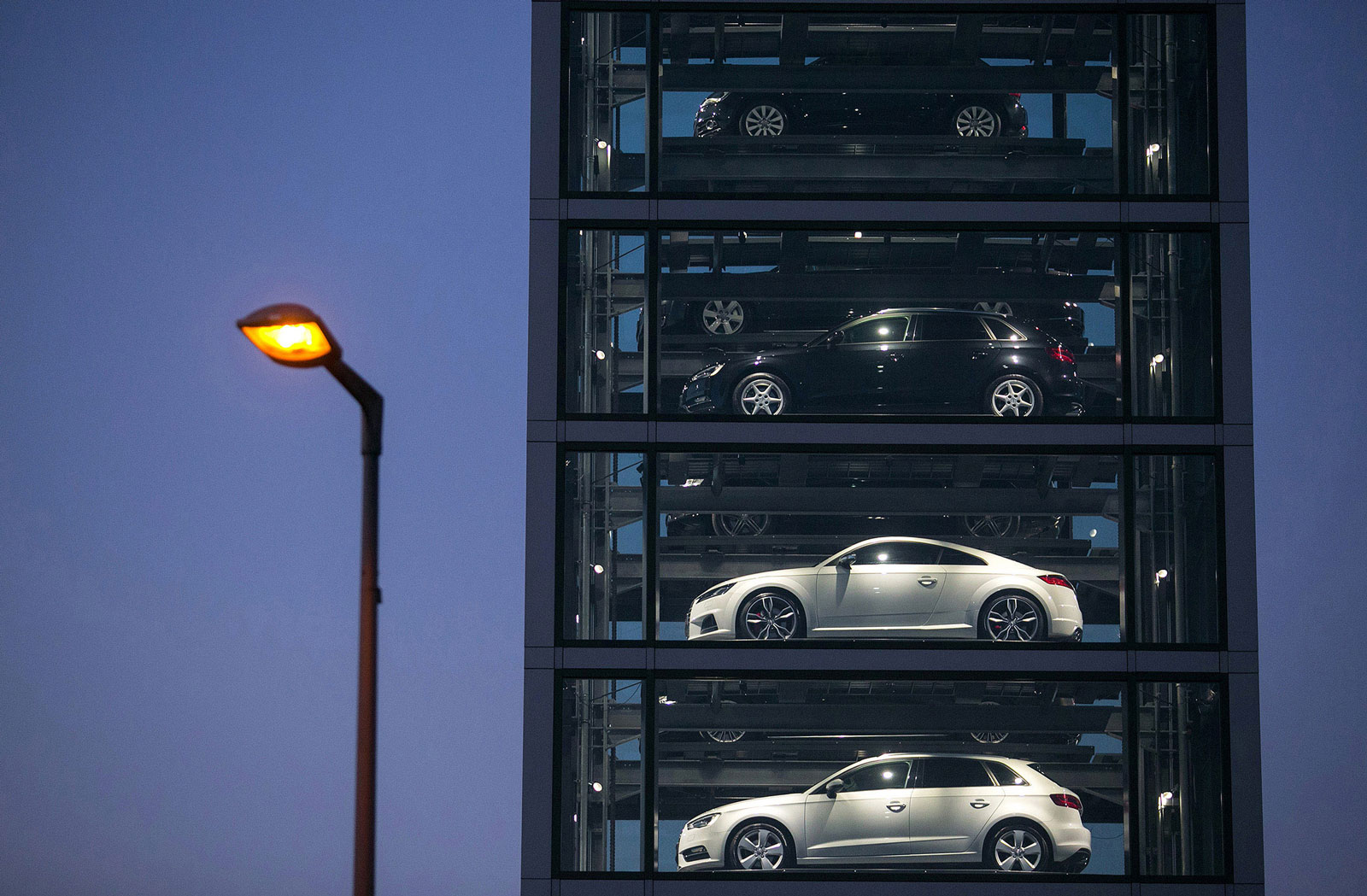 New Audi automobiles, produced by Volkswagen, sit on display at an Audi showroom
