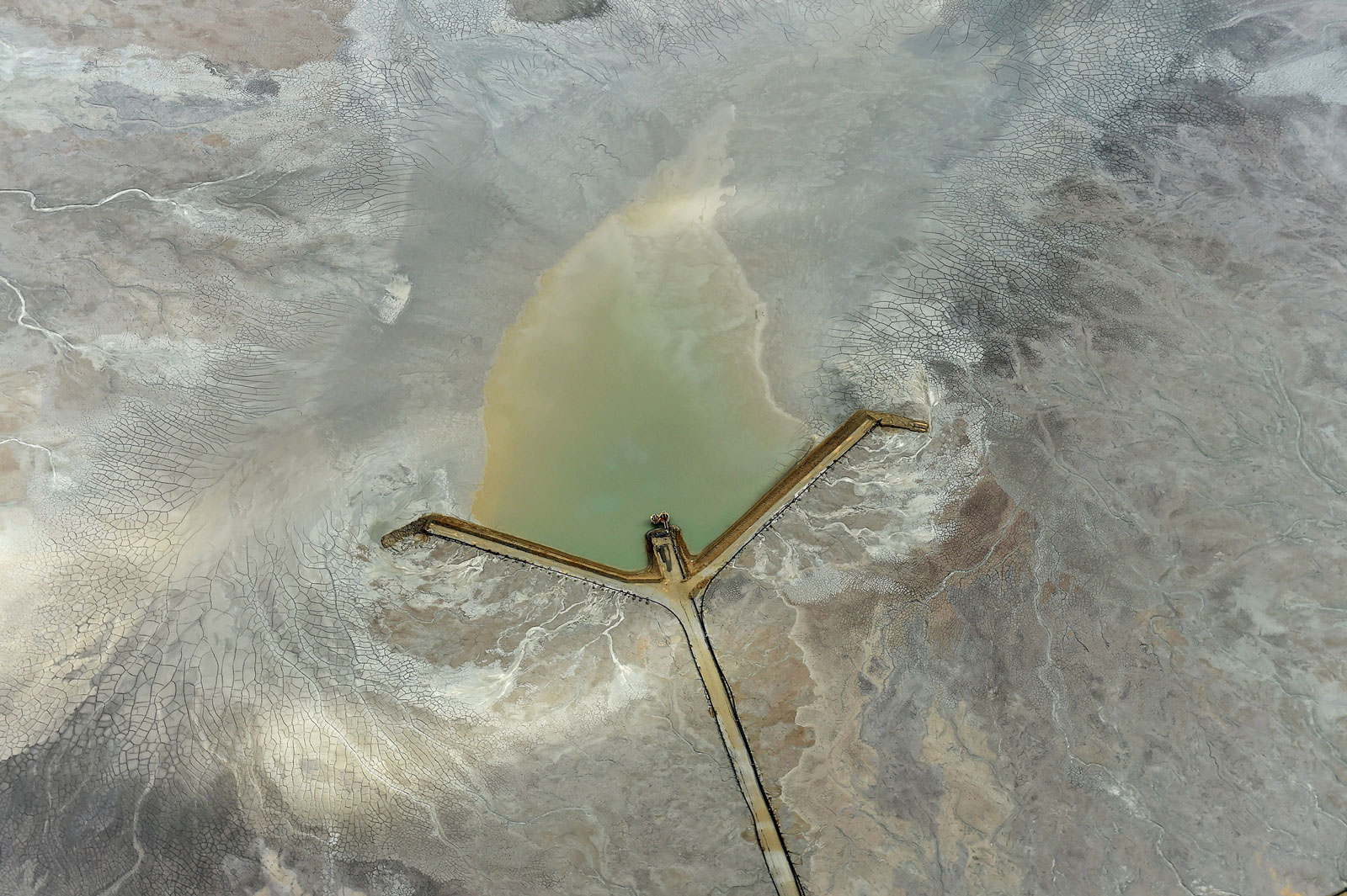 A road leads to the center of a tailings dam at the Fimiston Open Pit mine, in Kalgoorlie, Australia