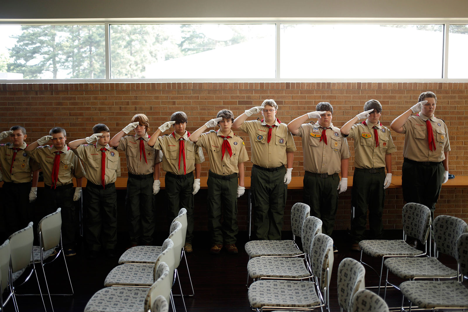 Boy Scouts from Troop 5 practice saluting at an event at Hempstead Hall in Hope, Ark.