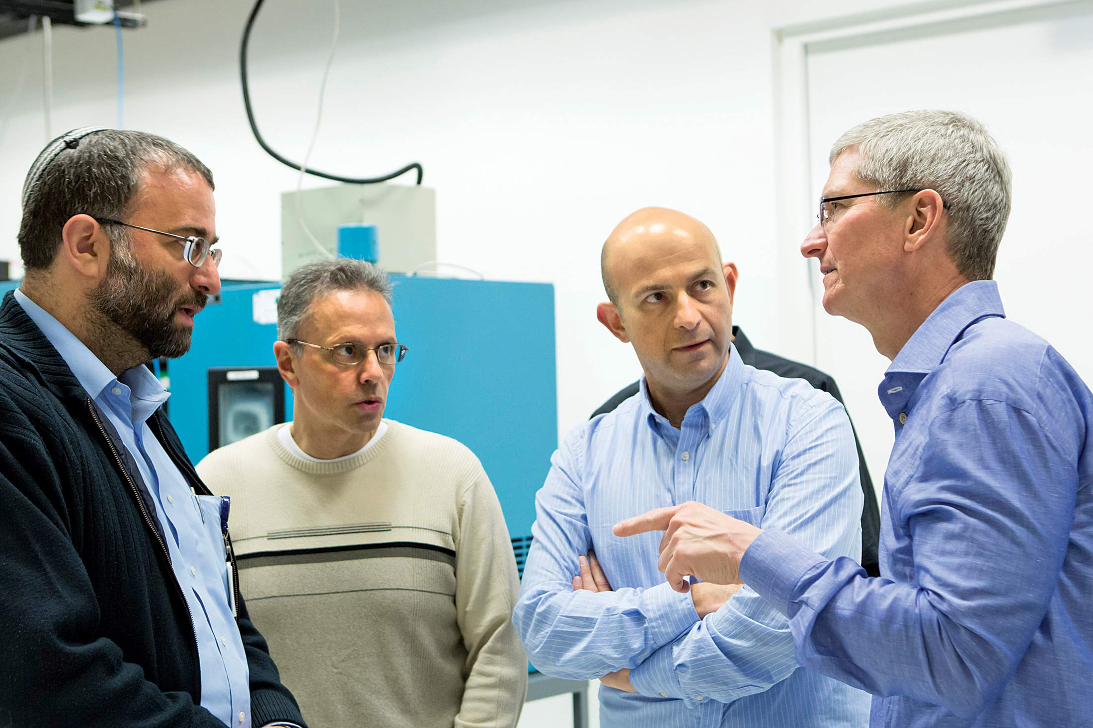 In Israel, Srouji (second from left) and Cook (right) with Apple employees