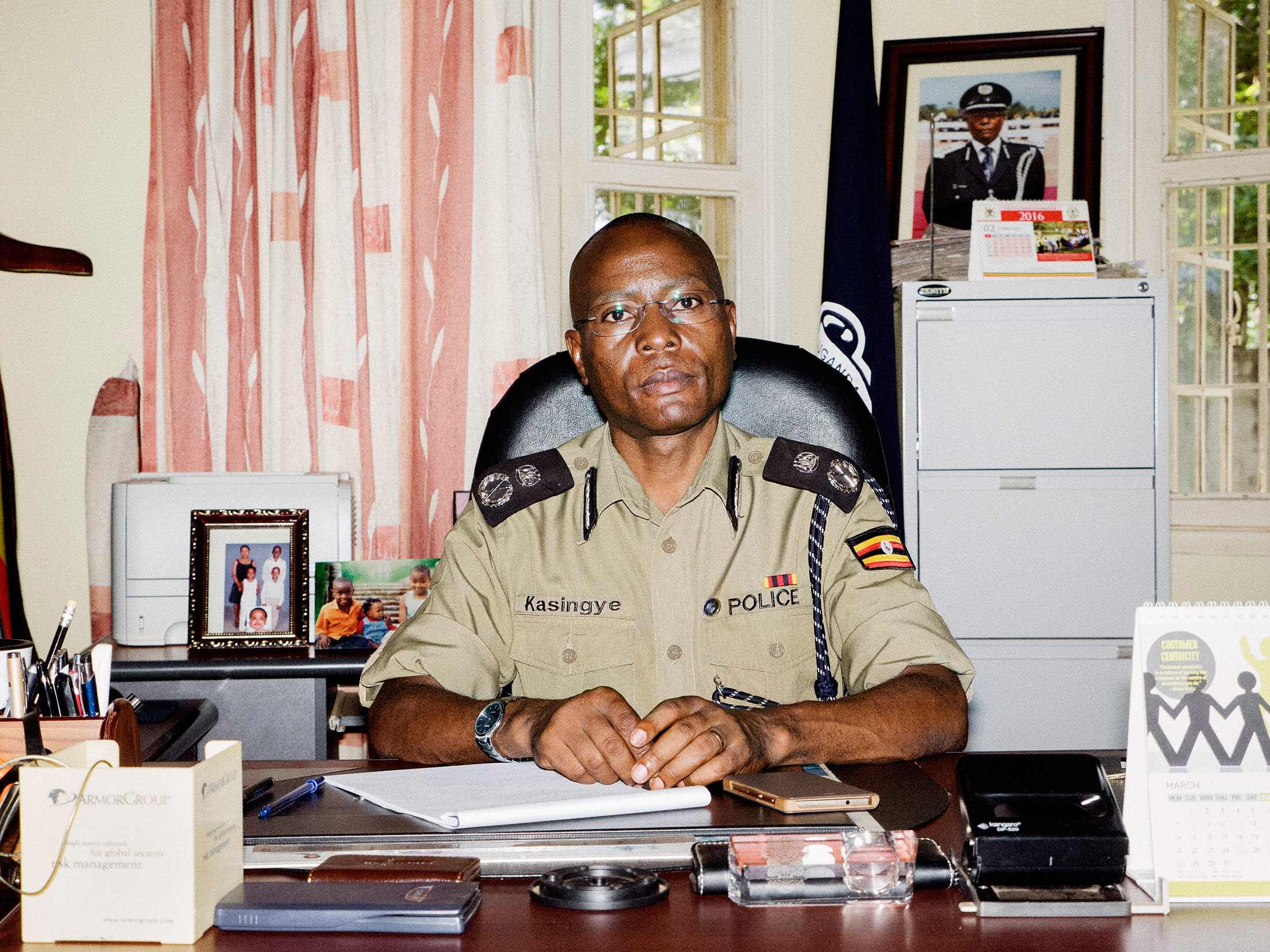 Kasingye Ugandau0027s Interpol chief in his office.  sc 1 st  Bloomberg & Ugandau0027s Top Export: Mercenaries