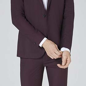 d4d5ab0e2 A slightly cropped jacket and the rich burgundy color give this suit a  youthful feel.