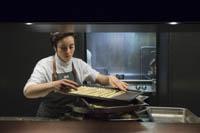 Donatella D'Agostino readies trays of breadsticks.