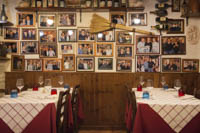 There's hardly a square inch of wall at Trattoria da Danilo that isn't covered by photographs or soccer jerseys.