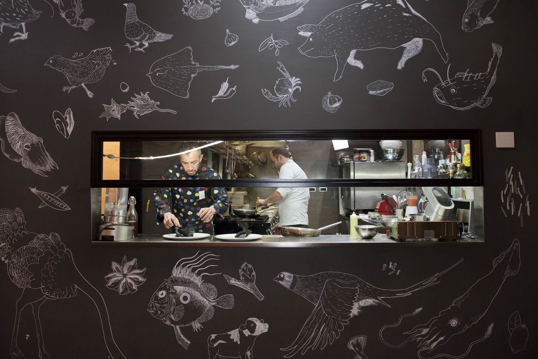 Chefs Valerio Chiacchierini, left, and Davide Lombardi in action in their semiopen kitchen.