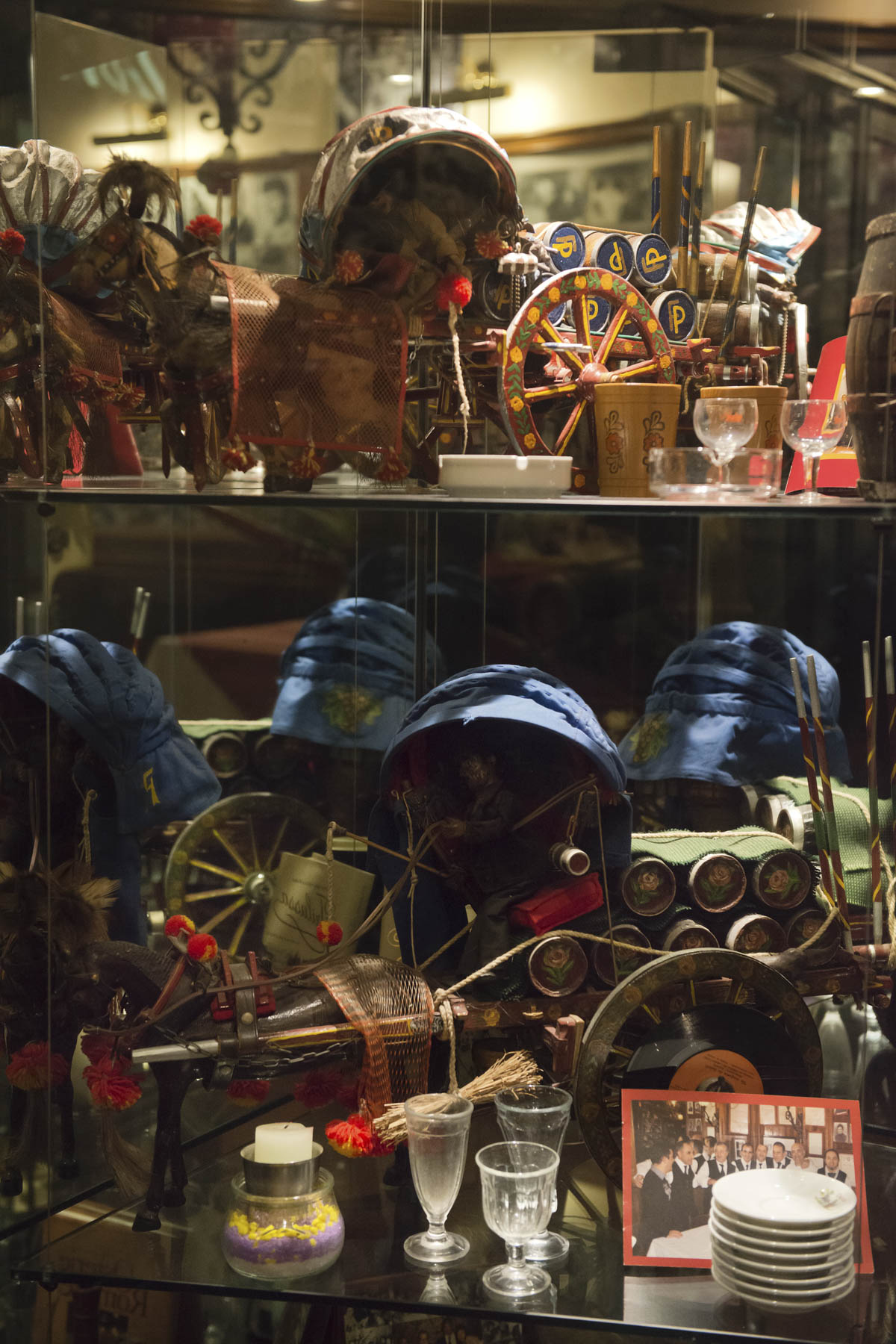 """Glass cases filled with donkey cart knickknacks commemorate the early life of restaurant founder Francesco """"Checco"""" Porcelli."""